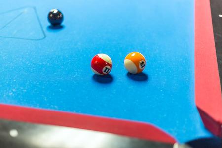 billiards halls: Balls on a pool table with blue felt Stock Photo