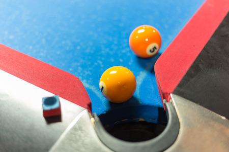 Ball near corner pocket of a pool table Stock Photo