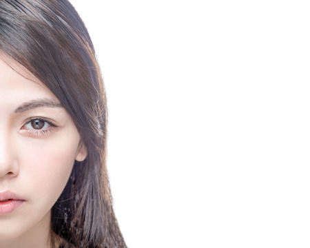 Half of Chinese Asian female face isolated on white background
