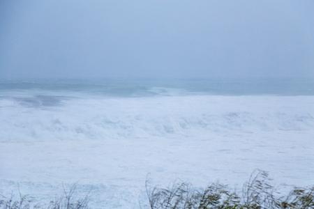 waves crashing: Big waves crashing during a typhoon