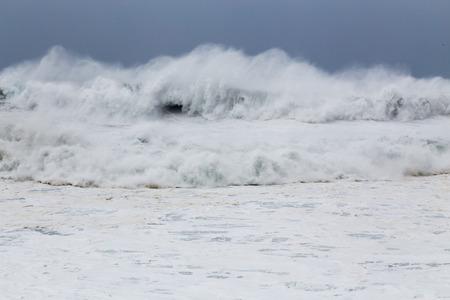 waves crashing: Stormy sea with waves crashing on rocks during Typhoon Souledor Stock Photo