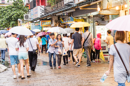 eating area: NEW TAIPEI CITY, TAIWAN - AUGUST 30, 2015: People walking around pedestrian shopping area by Danshui Old Street and Waterfront