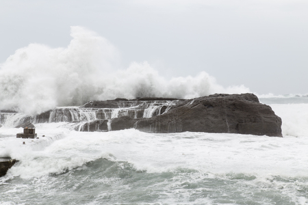 stormy sea: Stormy sea with waves crashing on rocks during Typhoon Souledor Stock Photo