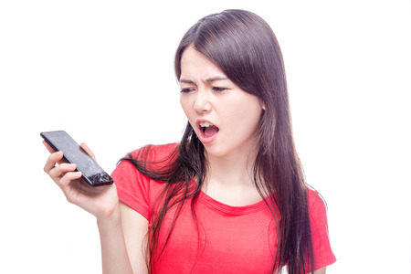 confuse: Asian woman frowning unhappily at broken smart phone
