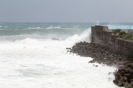 typhoon: Stormy sea during Typhoon Souledor. waves crashing on barrier wall