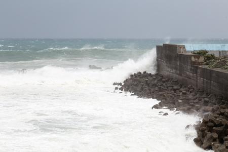 waves crashing: Stormy sea during Typhoon Souledor. waves crashing on barrier wall