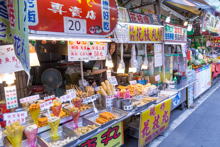 NEW TAIPEI CITY, TAIWAN - SEPTEMBER 11, 2015: Street food at Danshui shopping area Editorial