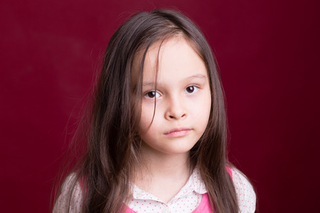 8 year old girl: Young Asian American girl looking unhappy