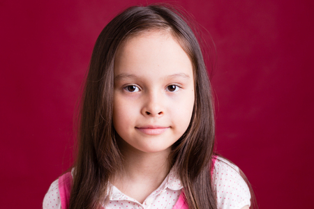 asian american: Young Asian American girl on red background Stock Photo