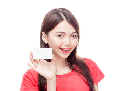 Chinese woman holding blank business card Stock Photo