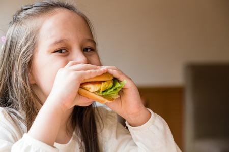 asian american: Asian American girl eating burger