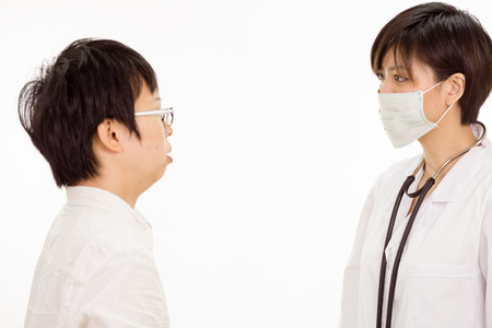 Chinese female doctor with patient