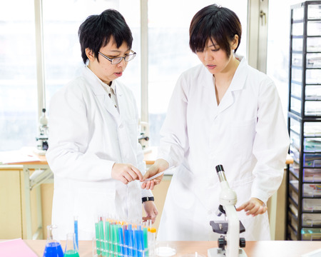 Female Chinese scientists in a laboratory