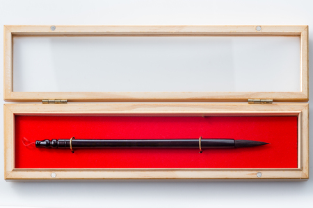 brush in: Chinese calligraphy brush in box on white background