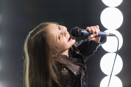 rockstar: Young rockstar girl singing on stage