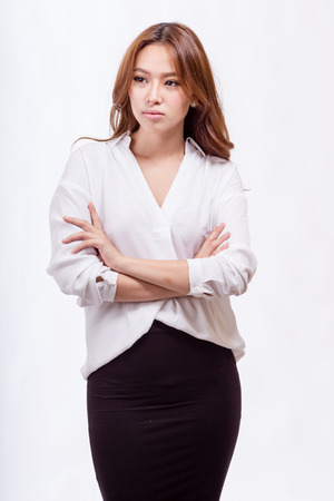 asian american: Asian American businesswoman with crossed arms Stock Photo