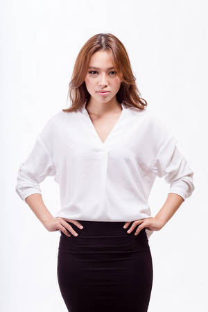 asian american: Attractive Asian American businesswoman with hands on hips looking at camera