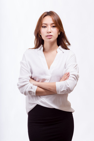 asian american: Asian American businesswoman with crossed arms looking at camera
