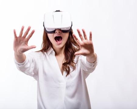 virtual reality simulator: Asian american woman wearing virtual reality headset