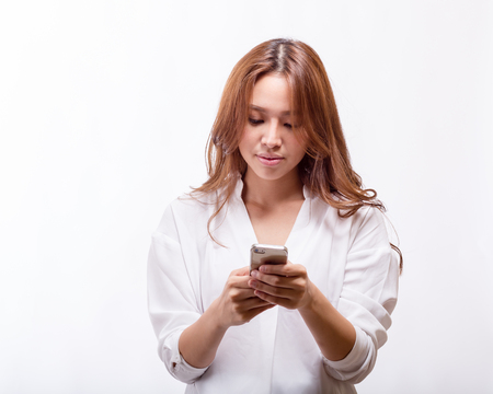 Chinese woman texting with a smart phone, copyspace