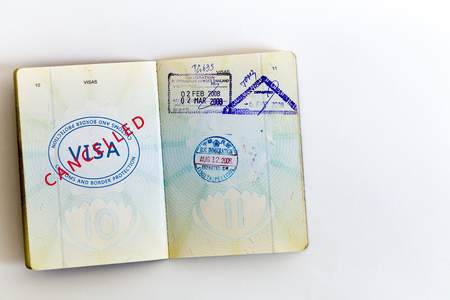 Visa cancelled and customs stamps in passport