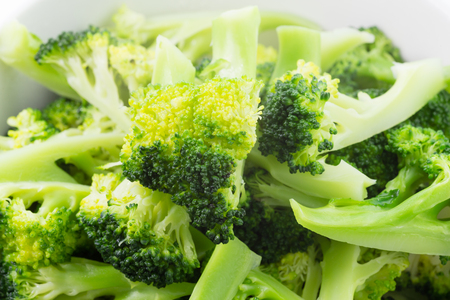 Fresh steamed green broccoli in bowl