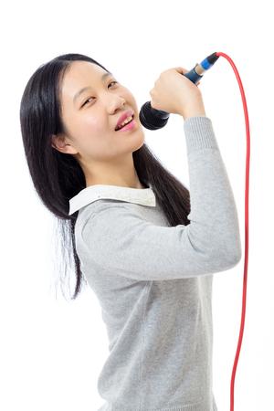 Chinese teenage girl holding microphone Stock Photo