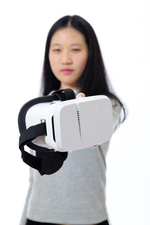 Defocused teenage girl passing 3D goggles