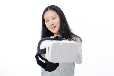 Teenage Asian girl passing 3D goggles Stock Photo