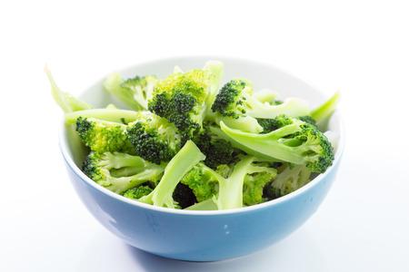 Fresh steamed green broccoli in bowl
