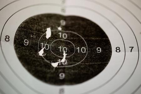 Bullet holes in shooting range target Stock Photo