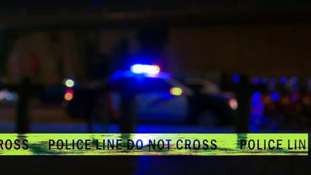 Siren on police car flashing, crime scene boundary tape, grunge texture, Defocused
