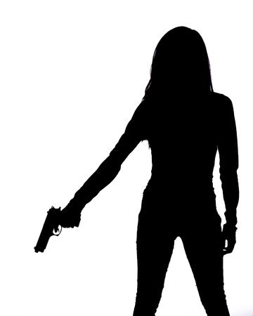 白い背景の上のピストルを持つ女性のシルエット