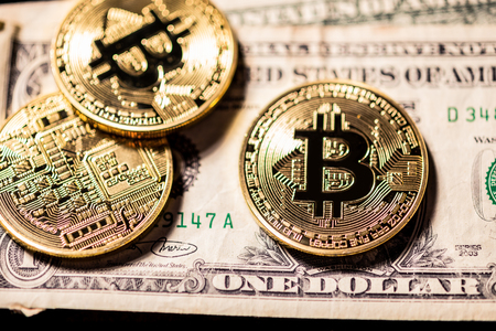 Bitcoins on outdated obsolete dollar bills, old vs new Stock Photo