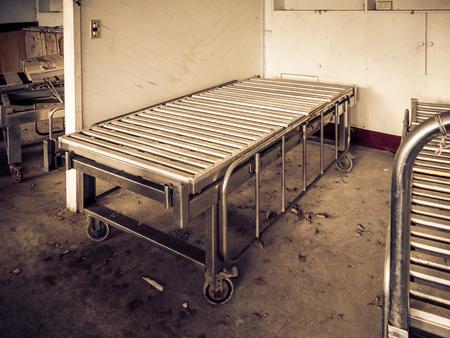 Hospital bed at abandoned mental hospital