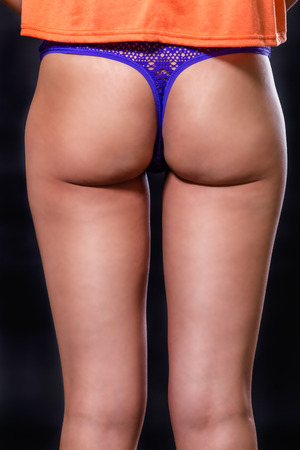 Close up of female buttocks in blue lingerie Stock Photo