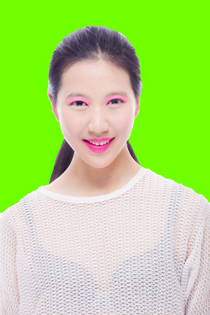 Portrait of Asian high school girl on bright green background, skincare concept Stok Fotoğraf