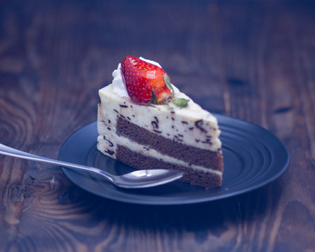 Chocolate and cheese cake on distressed wood background