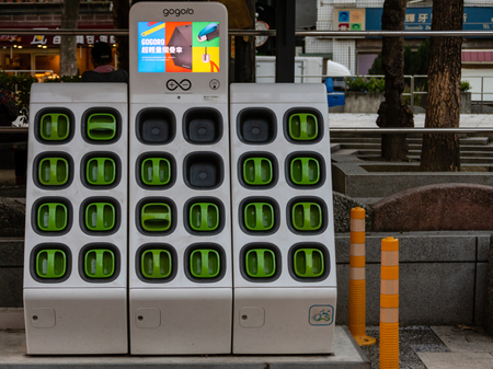 Taipei, Taiwan - Dec 1, 2018: Charging station for battery packs of Taiwan-based Gogoro electronic scooters Editöryel