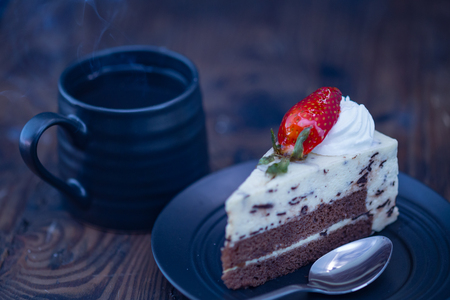 Coffee and chocolate and cheese cake on distressed wood background