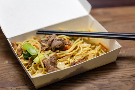 Chinese pork fried rice in lunchbox with chopsticks Stok Fotoğraf