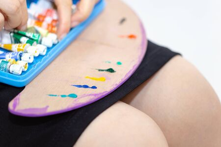 Gauche paint on artist's palette.