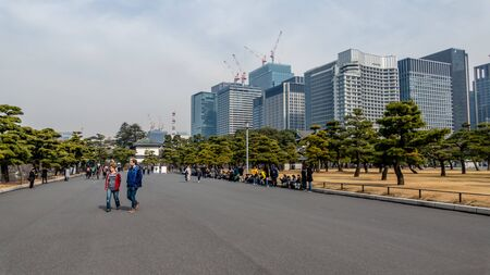 TOKYO, JAPAN - FEBRUARY 7, 2019: People in line to buy tickets to Tokyo Imperial Palace  Kikyomon Gate an entrance Japan