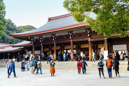 TOKYO, JAPAN - FEBRUARY 7, 2019: Crowds of tourists in Meiji Shrine in Shibuya, Tokyo. The shrine is officially designated Kanpei-taisha, the 1st rank of government supported shrines.