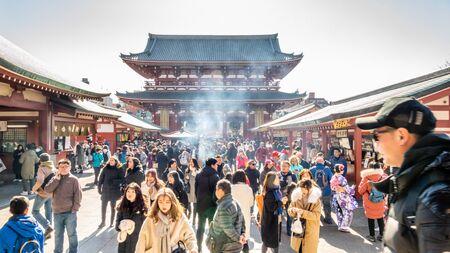 TOKYO, JAPAN - FEBRUARY 1, 2019: Crowds of tourists visit Sensoji Temple in Asakusa prefecture, Tokyo. Senso-ji Buddhist temple is dedicated to the bodhisattva Kannon Editorial