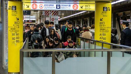 TOKYO, JAPAN - FEBRUARY 2, 2019: Commuters at Japanese subway train station