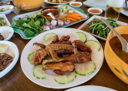 Selection of burmese dishes in rural Myanmar with skinny chicken and traditional soup Standard-Bild - 140330210