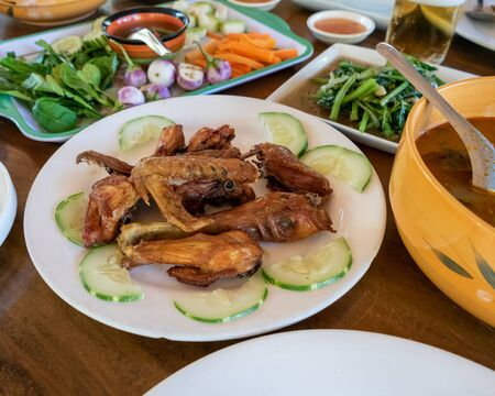 Selection of burmese dishes in rural Myanmar with skinny chicken and traditional soup