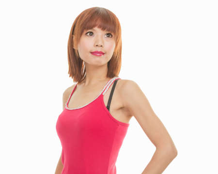 Asian female model in red dress looking away from camera