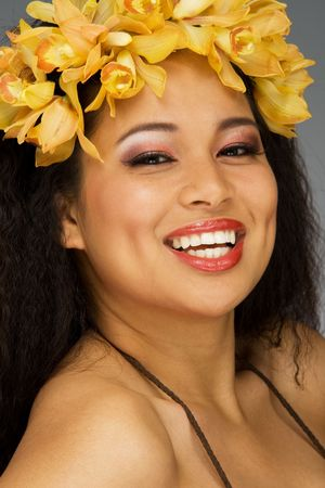 Ethnic young woman in flower head dress photo